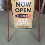 hanging a frame promotional sign 225x300 150x150 Metal Signs